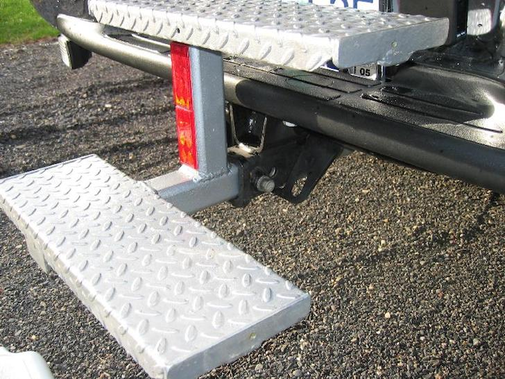 Close up view of DIY steps on a Lance truck camper