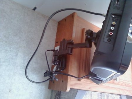 Articulating ARM Connected to Cabinet