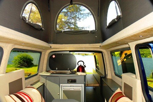 Inside the camper with the roof popped up