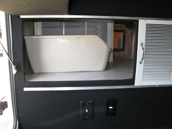 Litter box inside an RV's storage bay