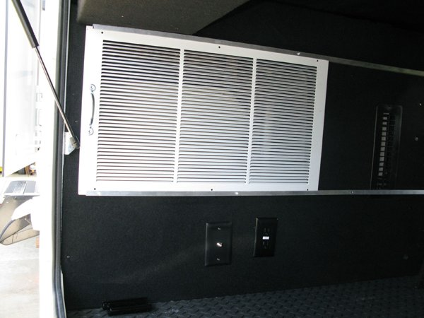 Sliding grate inside the storage compartment
