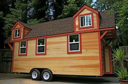 This tiny house trailer was built in 2011 and put up for sale on craigslist  where it sold 38 000 out of the Santa Cruz California area Tiny House Trailer RV Made Redwood Custom Fold Up Deck