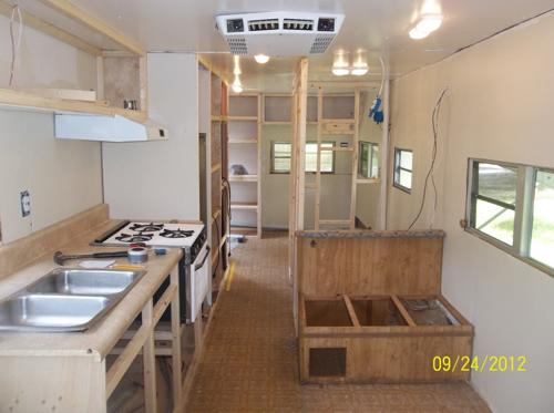 They Then Began To Rebuild The Infrastructure Of Their Transforming Travel Trailer Reinforced Tire Wells Walls Rebuilt Kitchen Cabinets