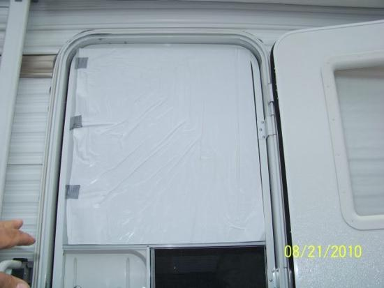 Top half of the installed RV storm door