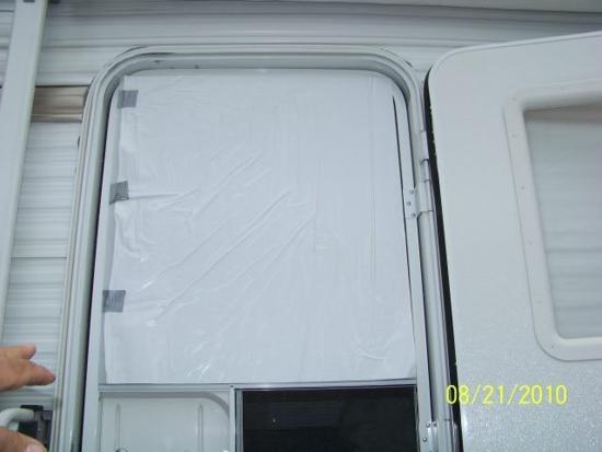 Top half of the installed RV storm door
