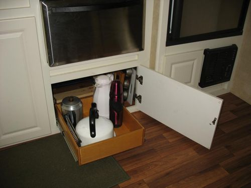 Clever RV Cabinet Storage Idea for Pans, Sheets, and Cutting Boards