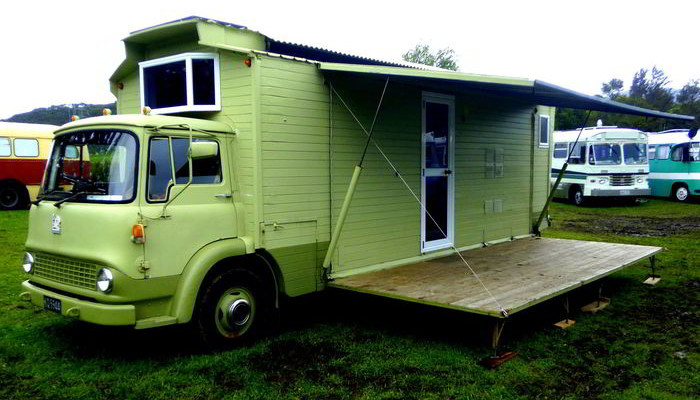 Eye Catching Custom Built Vintage Caboose RV With a Fold Down Deck
