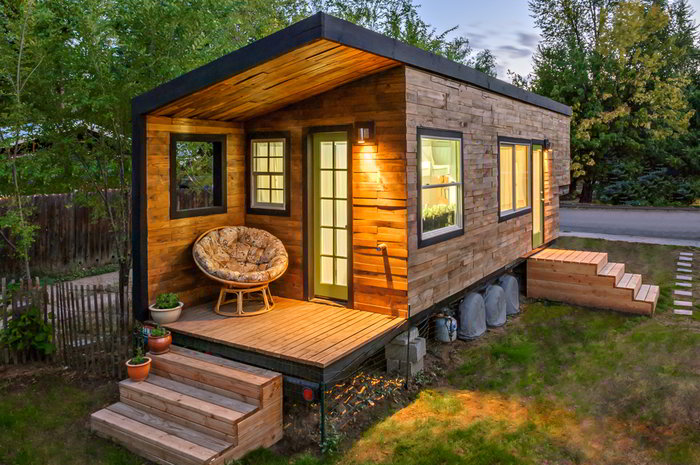 Stunning tiny house built on a gooseneck flatbed trailer Custom made houses