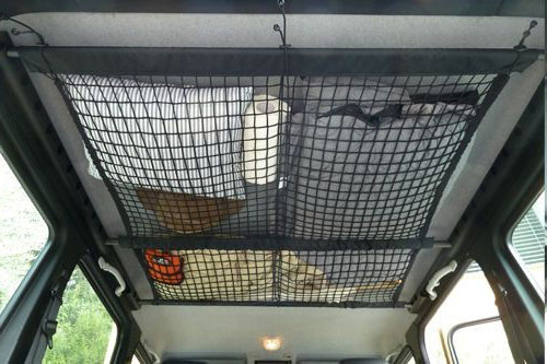 Use A RV Ceiling Cargo Net To Add Function to Wasted Space