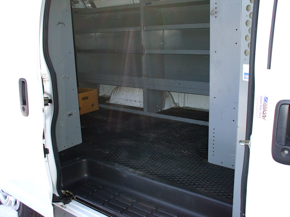 inside of a commercial van with shelving