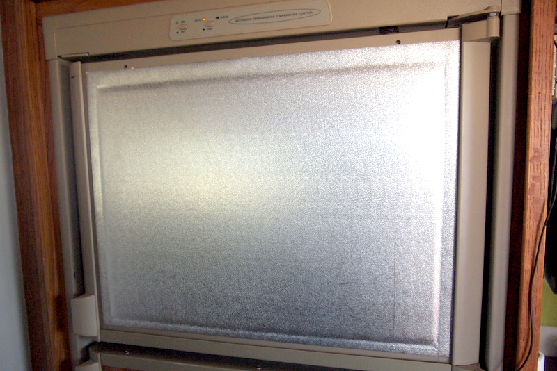 Behind the original panel is a layer of insulation
