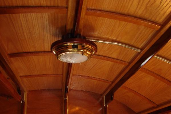 Brass gussets on ceiling