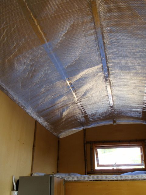 Insulating the roof with foil-lined air bubble insulation