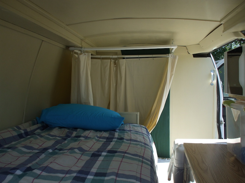 Larger bed along one side of the van