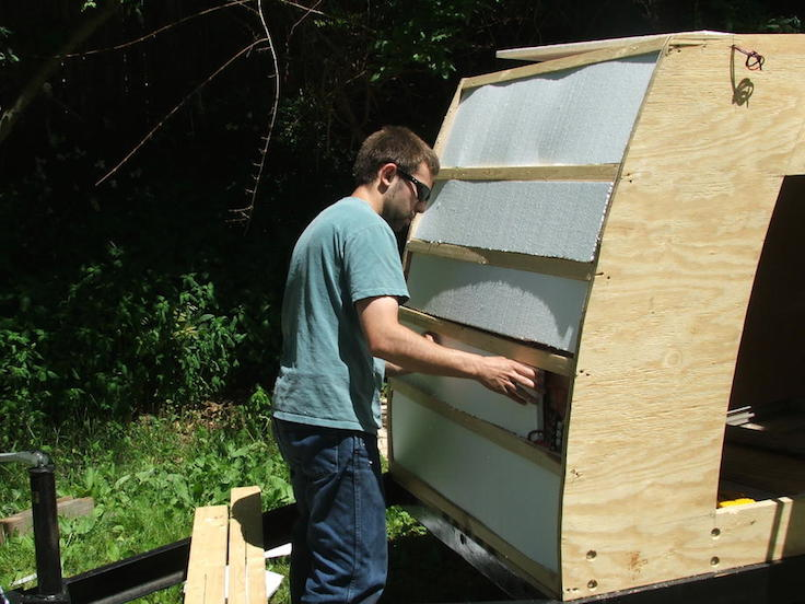 adding rigid foam insulation to the trailer