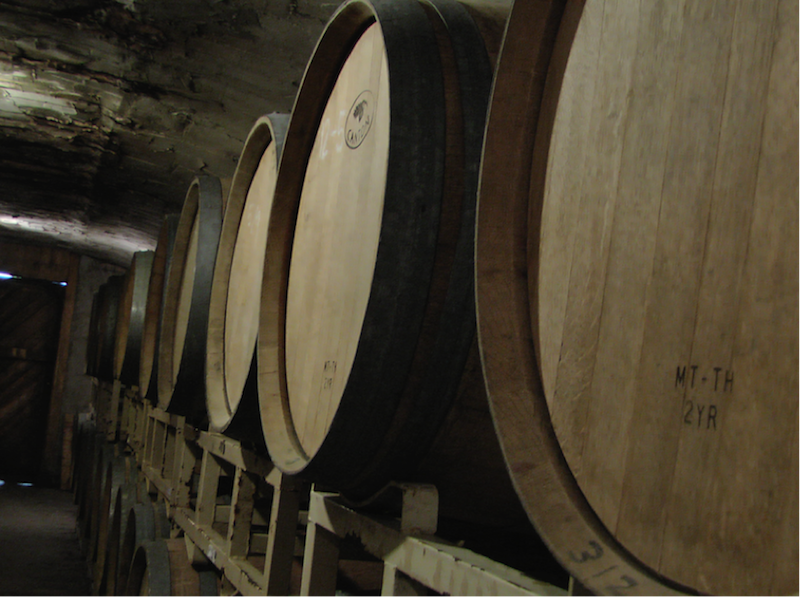 barrels of wine at carlos creek winery in minnesota