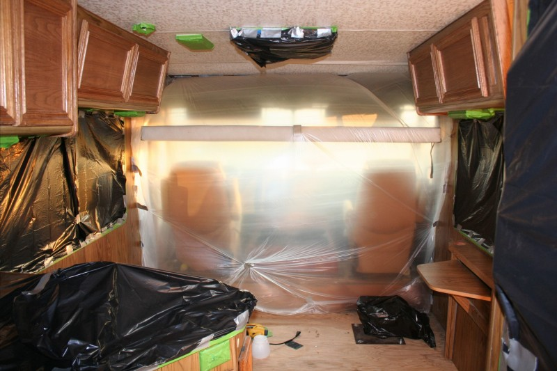 cab is sectioned off from rest of motorhome during painting