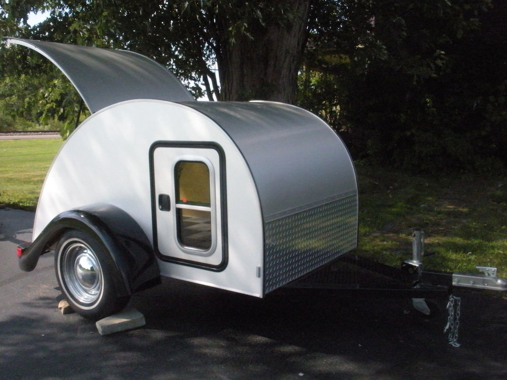 custom tear drop camper with chrome rims