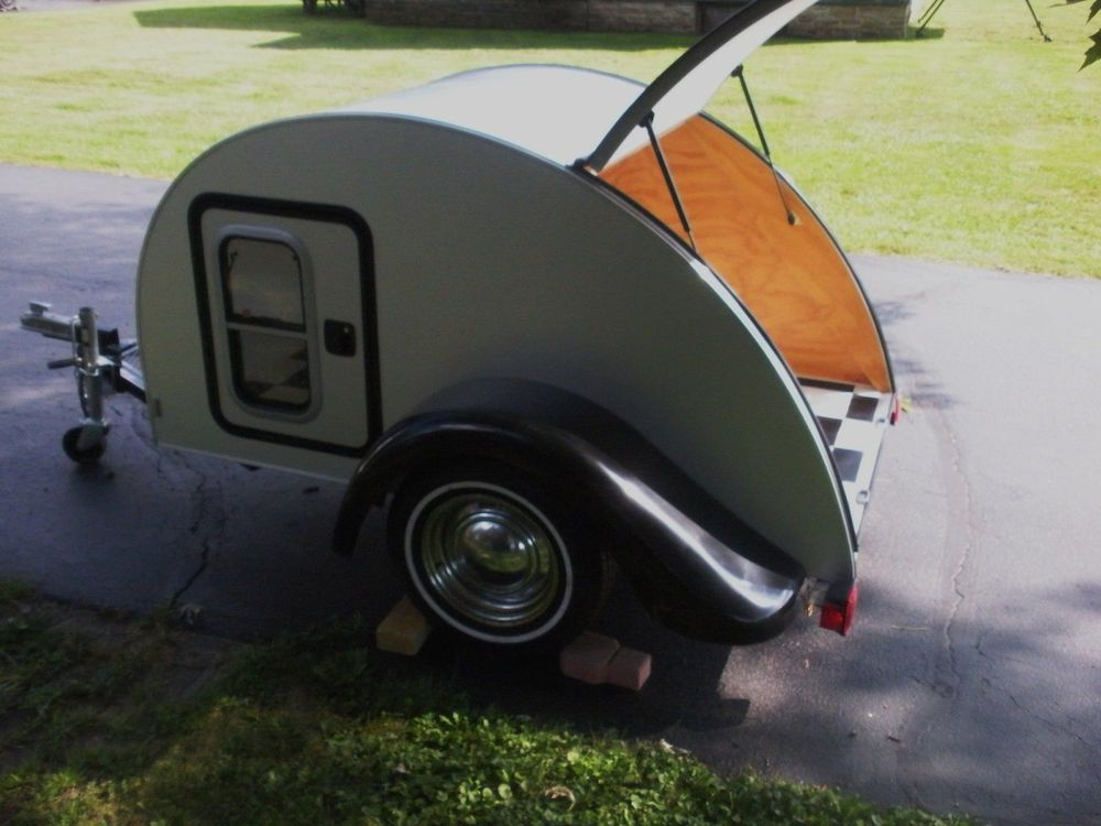 outside of tear drop camper with moon hubcaps