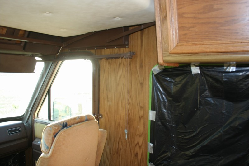painters tape around garbage bags in a motorhome remodel painting