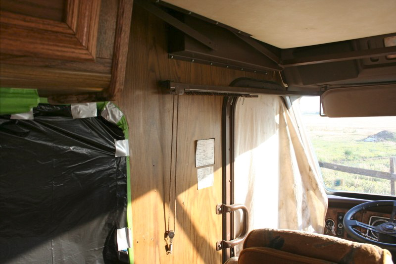 taping off around wood paneling in a motorhome prior to repainting