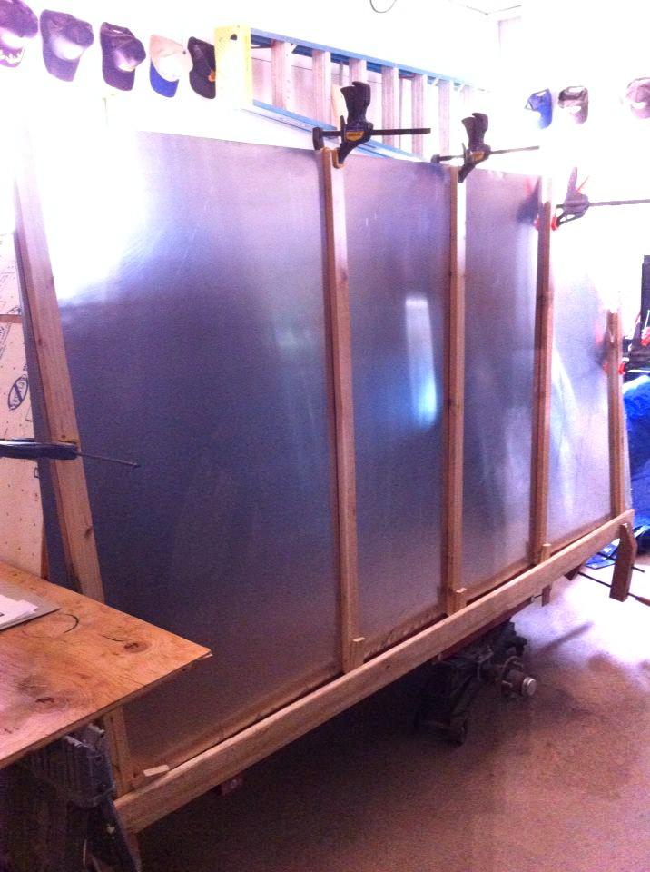using a jig to set the sheet metal siding