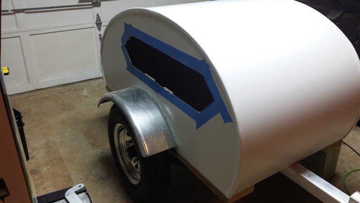 After installing the boat window into the doggie teardrop camper
