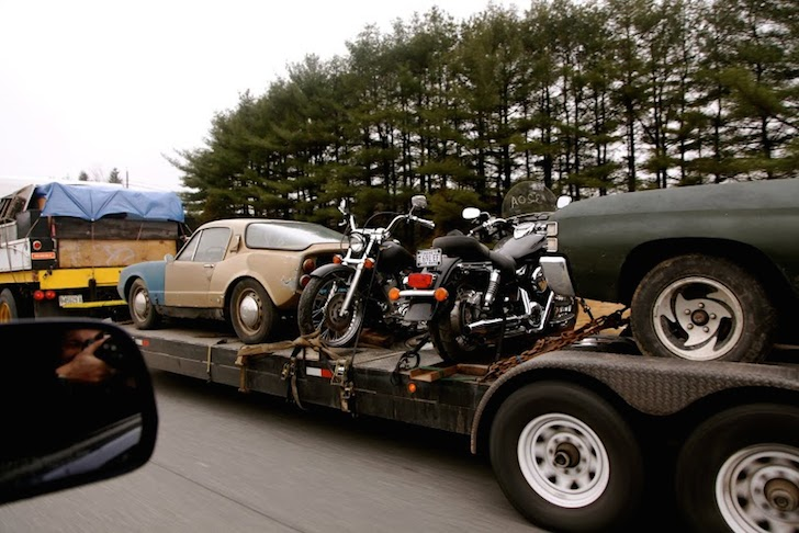 Check that, three vintage motorcycles