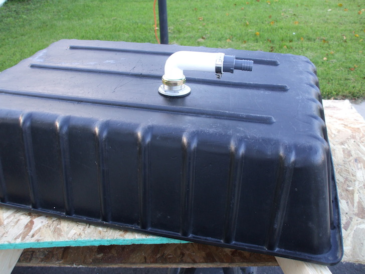 Concerete mixing tub with sink drain kit