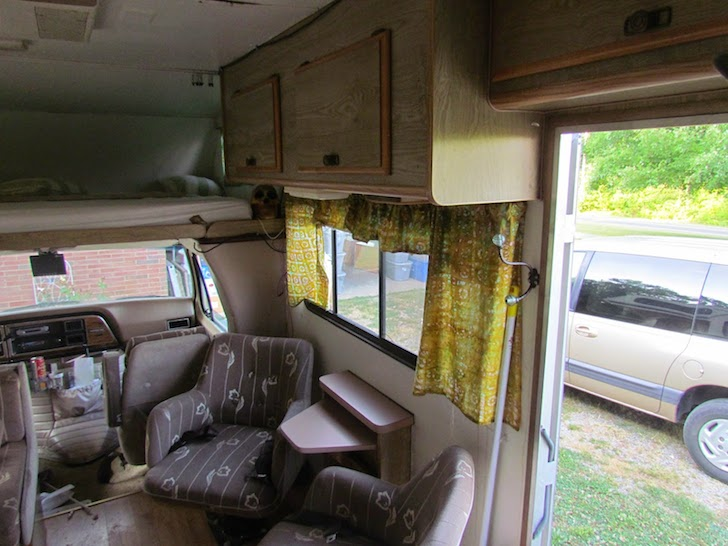 Entranceway and sitting area in a Class C motorhome