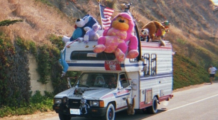 Front of a Toyota RV with a bunch of stuffed animals