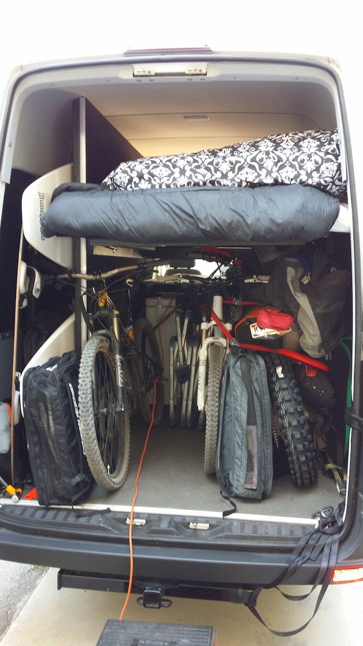 Lots of bikes and toys in the back of this custom Sprinter conversion van
