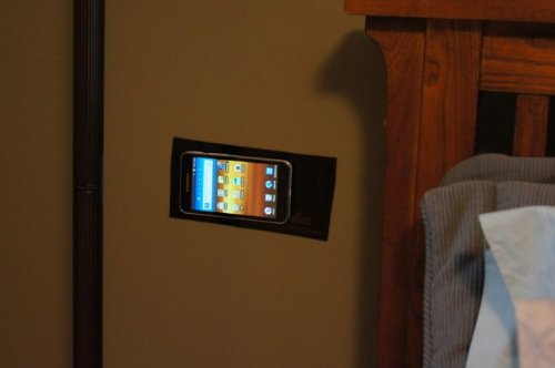 PuGoo holding a smartphone on a wall for easy access