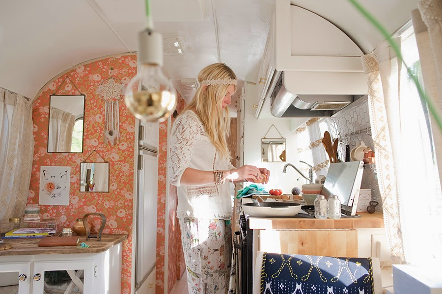 Sarah at work in the kitchen of her Airstream