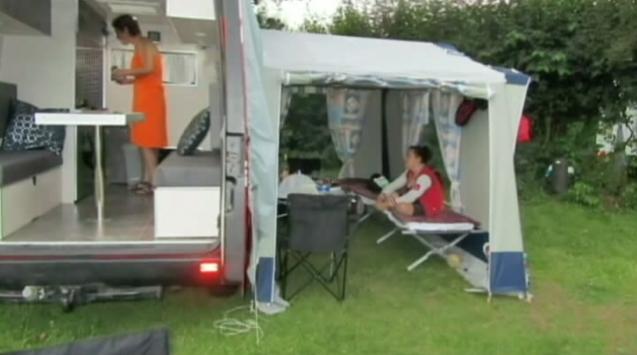 Tent hooked up to the camper van