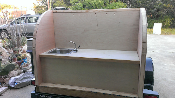 The camper has a traditional tear drop layout with a rear kitchen