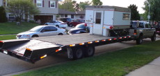 Did This Guy Just Put a Truck Camper on a Flatbed Trailer? Yeah, He Did. And It's Amazing.