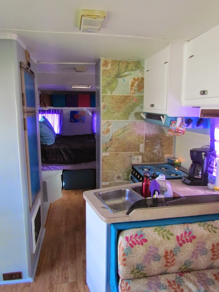 Walls in this Tioga motorhome  are paneled with maps