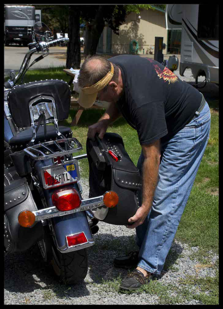 Chris preparing his Harley-Davidson motorcycle