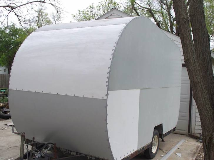Custom camper after installing the siding
