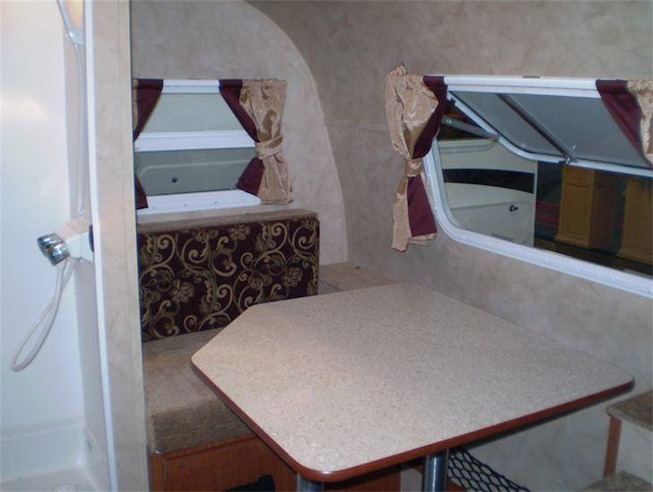 Dinette inside the Model 155 from Riverside RV