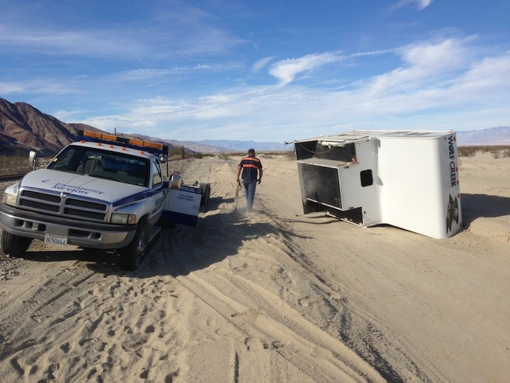 Help arrived to take the damaged Wolf Creek camper out of the desert