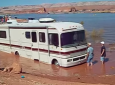 Motorhome gets stuck in a mud pit