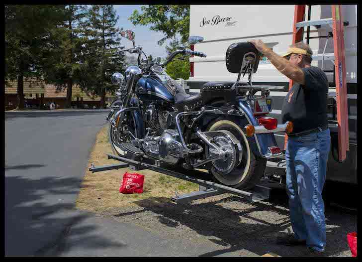 Raising the motorcycle into position on the Hydralift