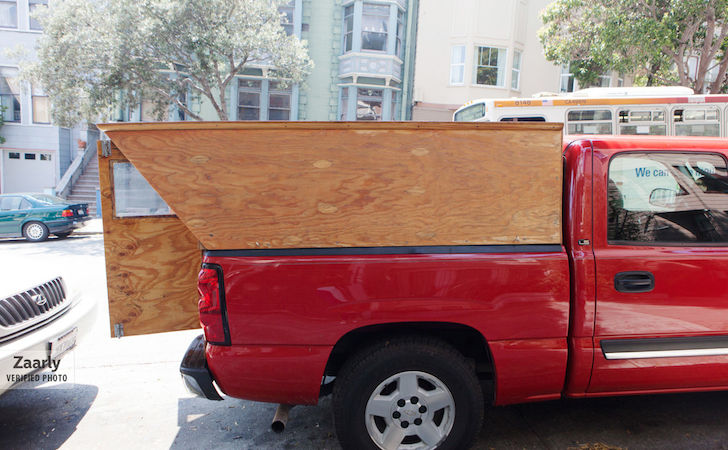 Rear doors open on custom wooden truck camper