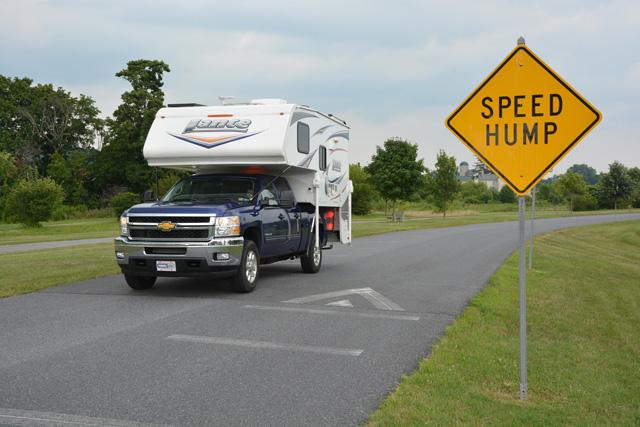 Truck camper going over a speed bump