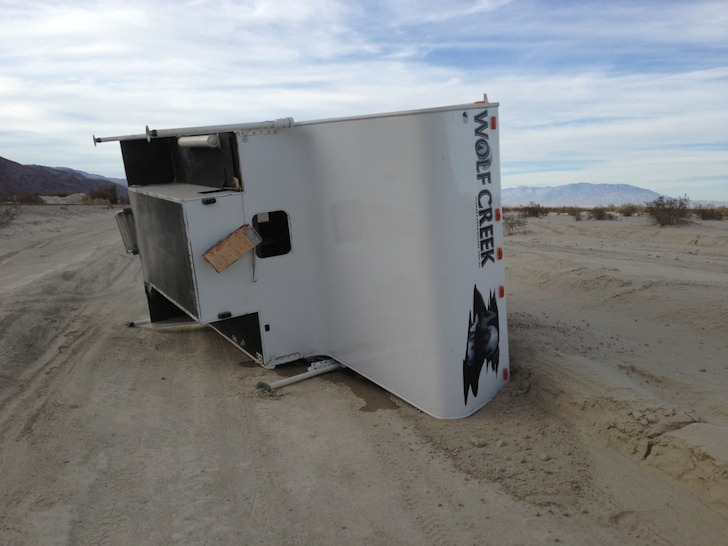 Truck camper on its side - not a pretty site