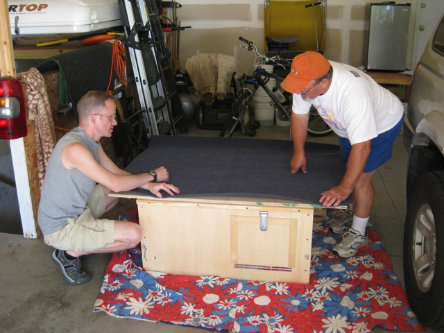 Adding carpeting to the top of the homemade storage locker