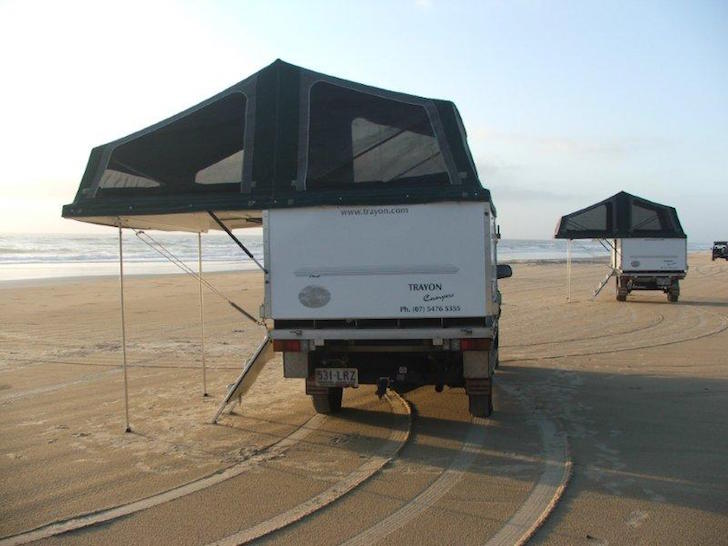 Hanging out on the beach in a Trayon camper