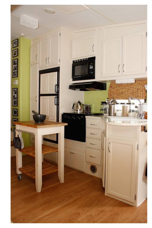 Kitchen with custom painted, moveable island storage